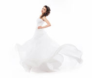 Bride in wedding fashion white dress running Royalty Free Stock Photography