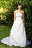 Bride in wedding gown outside Royalty Free Stock Photography