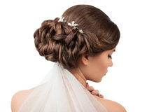 Bride with wedding hairstyle and veil. On a white background Stock Photo