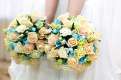The bride at wedding holding a bouquet of flowers. Stock Photography