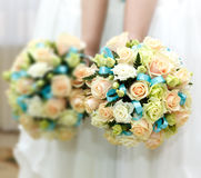 The bride at wedding holding a bouquet of flowers. Stock Images