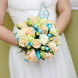 The bride at  wedding holding a bouquet of flowers. Royalty Free Stock Photo