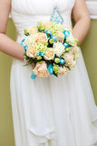 The bride at wedding holding a bouquet of flowers. Royalty Free Stock Image