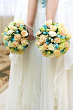 The bride at wedding holding a bouquet of flowers. Stock Photos