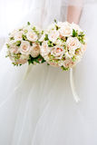 The bride at  wedding holding a bouquet of flowers. Royalty Free Stock Photography
