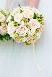 The bride at  wedding holding a bouquet of flowers. Stock Photo