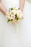 The bride at  wedding holding a bouquet of flowers. Stock Image