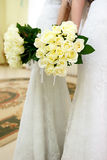 The bride at a wedding holding a bouquet of flowers. Royalty Free Stock Images