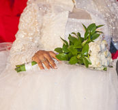 Bride at a wedding holding a bouquet Stock Photos