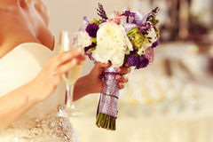 Bride wedding holding glasses of champagne flowers Royalty Free Stock Image