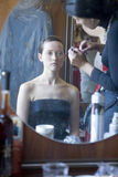Bride before wedding at home doing make up Royalty Free Stock Images