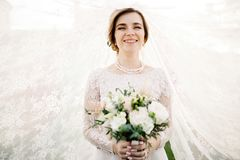 Bride with wedding makeup and hairstyle. Smiling bride. Wedding Royalty Free Stock Photo