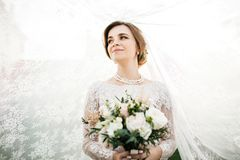 Bride with wedding makeup and hairstyle. Smiling bride. Wedding royalty free stock photography