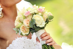 Bride with wedding rose bouquet Stock Photography