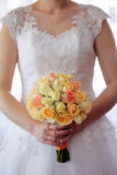 Bride with wedding rose bouquet outdoors Royalty Free Stock Image