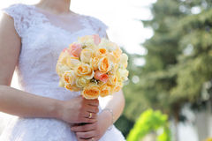 Bride with wedding rose bouquet outdoors Stock Photos
