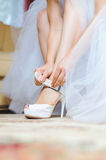 Bride and Wedding Shoe Stock Photo