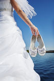 Bride with wedding shoes Royalty Free Stock Photos