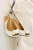 Bride wedding shoes is hanging on the hanger Royalty Free Stock Photos