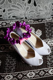 Bride wedding shoes white and purple garter Royalty Free Stock Image