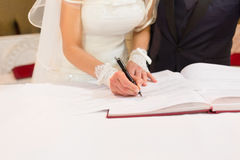 Bride wedding signature. Bride sign on registration of marriage Royalty Free Stock Image