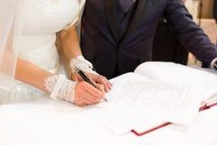 Bride wedding signature. Bride sign on registration of marriage Stock Photo