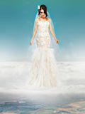 Bride in Wedding White Dress standing on a Cloud Stock Image