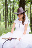 Bride with a whip Stock Image