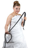 Bride with whip in white dress Stock Image