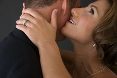 Bride Whispers into Groom's Ear Stock Photography