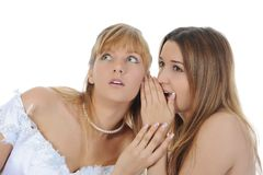 Bride whispers to friend Royalty Free Stock Photography