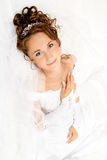 Bride on the white. Beautiful young bride on the white background Royalty Free Stock Images