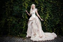 Bride in white. Blond attractive bride in white dress Stock Image