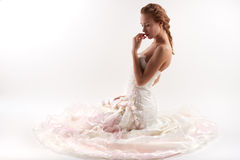 Bride on a white background. A beautiful bride in a dress on a white background Stock Photo