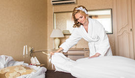 The bride in white bathrobe. Wedding preparations. Royalty Free Stock Images