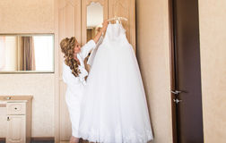The bride in white bathrobe. Wedding preparations. Stock Images