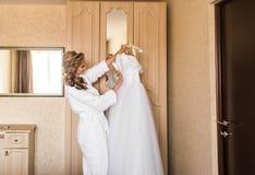 The bride in white bathrobe. Wedding preparations. Royalty Free Stock Photo