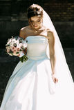 Bride in the white bridal dress with a bouquet Stock Photo