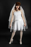 Bride in white dress armed with two pistols Royalty Free Stock Photos