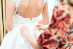 Bride in white dress backs to the camera. 1 stock photos