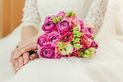 Bride in white dress with bouquet of roses Royalty Free Stock Photo