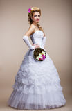 Wedding. Newlywed in White Dress holding Special Bouquet of Flowers Royalty Free Stock Photos