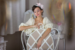 The bride in a white dress on the chair Royalty Free Stock Photo