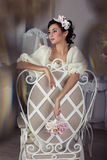 The bride in a white dress on the chair Stock Photography