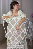 The bride in a white dress on the chair Royalty Free Stock Photography