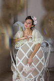 The bride in a white dress on the chair Stock Image