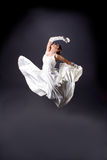 Bride in white dress dancing Stock Photo