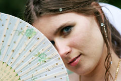 The bride in a white dress with a fan Stock Photo