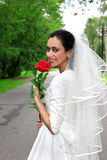 Bride in white dress with flower Royalty Free Stock Photography