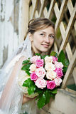 Bride in white dress with flowers Stock Image